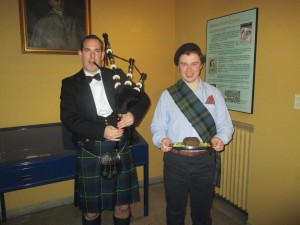 Kevin Rennie from the Diocese of Galloway prepares to Dance the Haggis in, led by piper for the night, Scott Allan from California